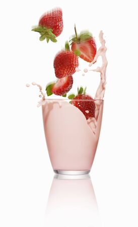 squirted: Strawberries falling into a glass of strawberry milk LANG_EVOIMAGES