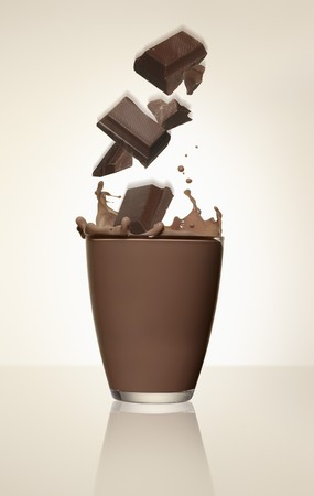 squirted: Pieces of chocolate falling into a glass of cocoa LANG_EVOIMAGES