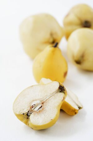 quinces: Quinces, whole and halved