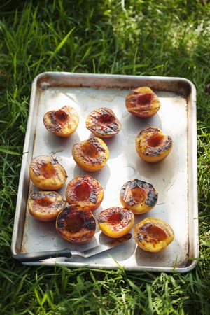 sweet grasses: Pan of Grilled Peach Halves on the Grass