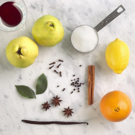poaching: Ingredients for Poaching Quince; Quince, Cinnamon, Orange, Lemon, Sugar, Vanilla, Clove, Star Anise, Bay Leaves, and Red Wine
