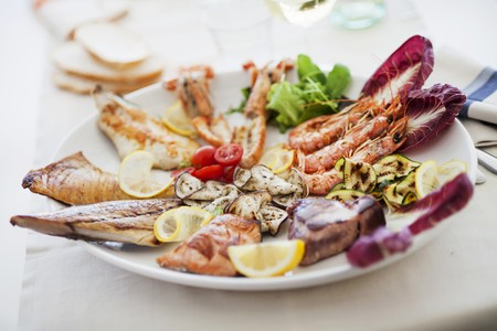 lean out: A plate of grilled food including seafood, fish and vegetables