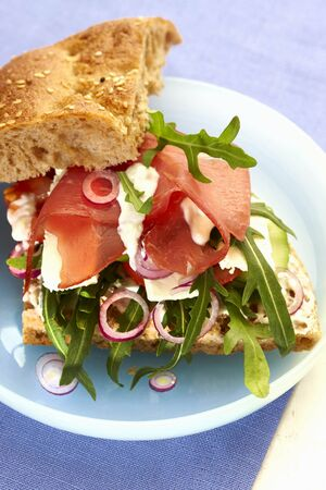 topped: Flat bread with rocket, cheese and dry-cured ham