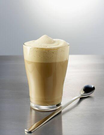 stirred: Stirred latte macchiato with spoon