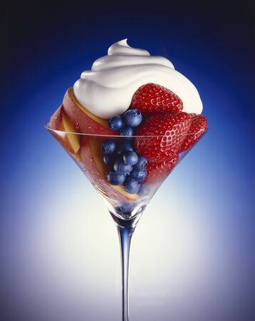 glass topped: Fresh Fruit Salad in a Stem Glass Topped with Whipped Cream
