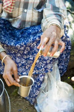 tea breaks: A tea picker drinking tea (Kerala, India)