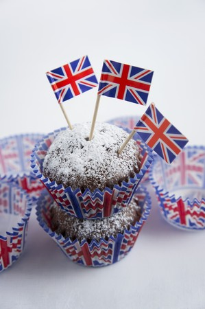 uk cuisine: Chocolate muffins dusted with icing sugar and flags (Great Britain)