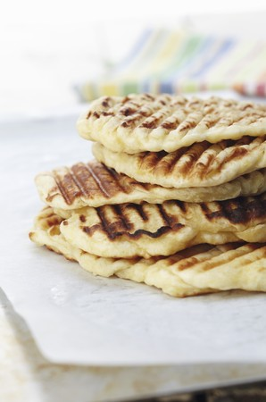 qs: A stack of grilled flatbread LANG_EVOIMAGES