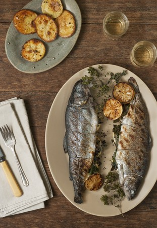 salmo trutta: Grilled Trout Stuffed with Lemon and Parsley on a Platter; Oven Roasted Potatoes and White Wine LANG_EVOIMAGES