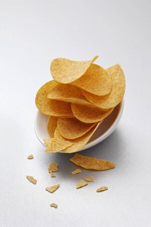 crisps: Potato crisps in bowls LANG_EVOIMAGES