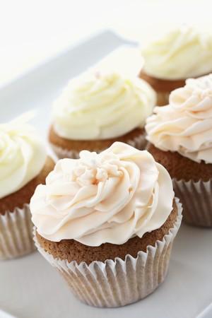 buttercream: Several buttercream cupcakes