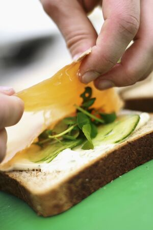 making a sandwich: Making a sandwich with smoked salmon LANG_EVOIMAGES