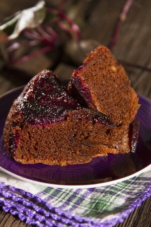 in twos: Two slices of chocolate cake