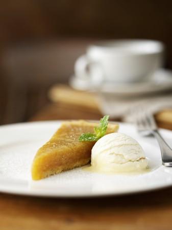 treacle: A piece of treacle tart with vanilla ice cream (UK)