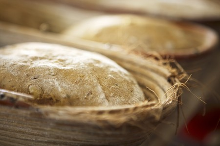 out of production: Unbaked bread in baking tins