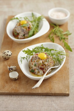 quail egg: Herring tartare with dried tomatoes, pickled cucumbers and quail egg