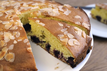 Sponge cake with blackberries and almonds, sliced