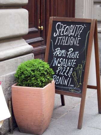 southern european: A menu at the entrance of a restaurant (Milan, Italy) LANG_EVOIMAGES