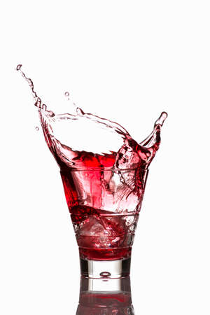 squirted: Campari spilling out a glass LANG_EVOIMAGES