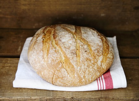 french bread boule: Boule (French white bread) on a tea towel LANG_EVOIMAGES