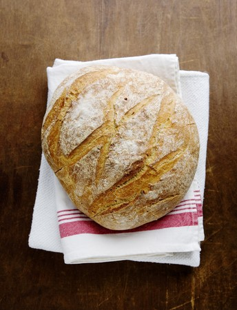 Boule (French white bread) on a tea towel LANG_EVOIMAGES