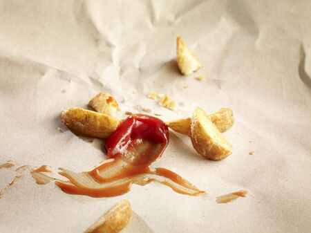 leavings: Potato wedges with ketchup