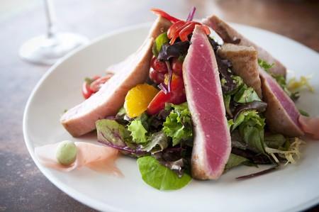 seared: Seared Tuna Salad on a White Plate