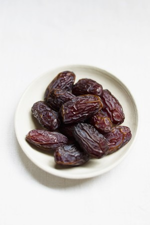dactylifera: Medjool dates in a small bowl
