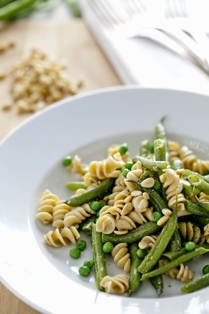 pine kernels: Pasta with Green Beans, Peas and Pine Nuts; In a White Bowl