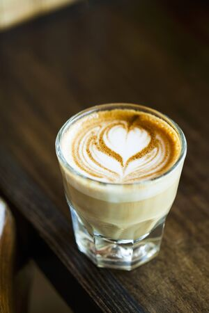 hot coffees: Latte with a Heart Design in a Glass LANG_EVOIMAGES