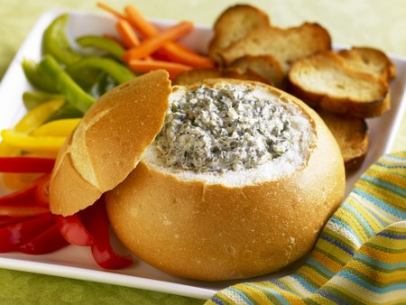 crudite: Spinach Dip in a Bread Bowl with Sliced Veggies and Toasted Bread Slices for Dipping LANG_EVOIMAGES