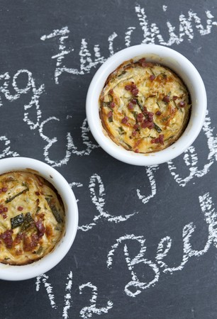 cocozelle: Two Individual Zucchini Casseroles on Chalkboard Surface