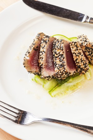 tunafish: Sesame Encrusted Seared Ahi Tuna in a Spicy Cucumber and Lime Vinaigrette