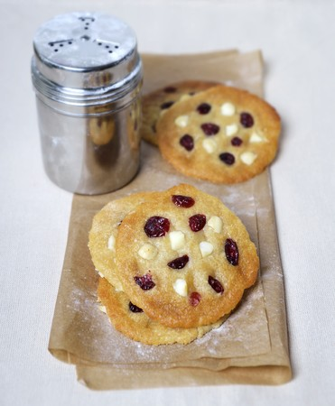 vaccinium macrocarpon: Macadamia nut and cranberry cookies and a sugar shaker LANG_EVOIMAGES