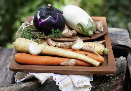 petroselinum sativum: Fresh root vegetables, garlic and aubergines for soup on a wooden tray