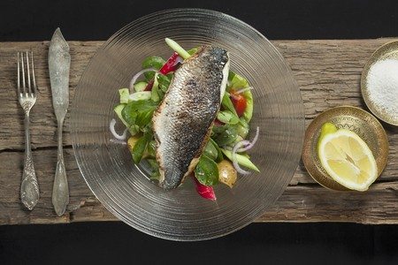 silver perch: Nile perch on a bed of salad, with lemon and sea salt