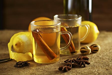 cinammon: White Glühwein (German mulled wine) with spices and lemons LANG_EVOIMAGES