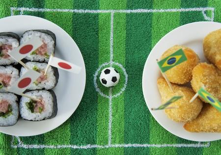 cuisines: Sushi (Japan) and salgadinhos (Brazil) with football-themed decoration