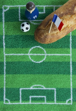 ec: A baguette with a French flag and football-themed decoration