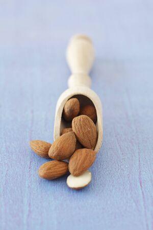 wooden scoop: Almonds on a wooden scoop