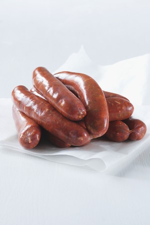 scalded sausage: Debrecener sausages on a piece of paper