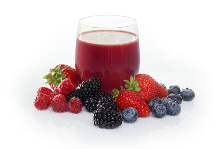 brambleberries: A glass of fruits of the forest juice surrounded by fruits of the forest