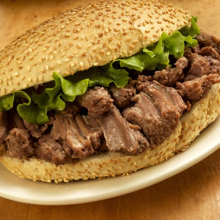 sesame seed bun: Pot Roast Sandwich with Lettuce on a Sesame Seed Bun