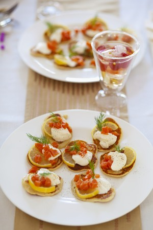 foeniculum: Mini pancakes with lemon slices, sour cream, smoked salmon and fennel tops