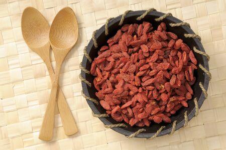 barbarum: Goji berries in a wooden bowl LANG_EVOIMAGES