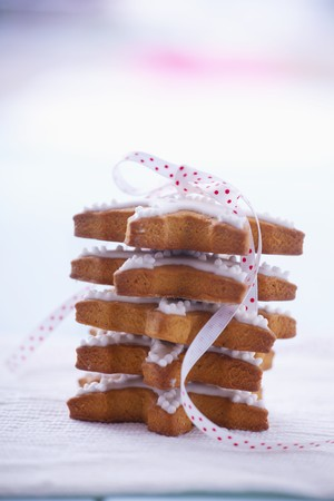 frost bound: Pile of gingerbread stars garnished with icing and tied with ribbon