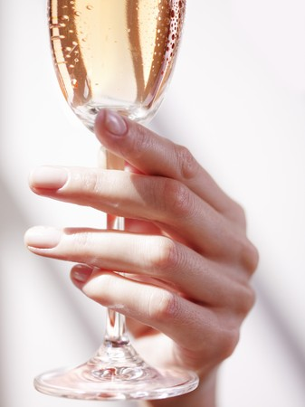 hold ups: A hand holding a glass of champagne