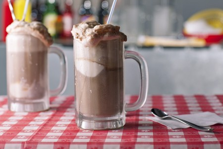 root beer: Two Root Beer Floats on a Table with Straws