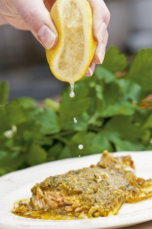 'main squeeze': Salmon trout with a herb crust being drizzled with lemon juice
