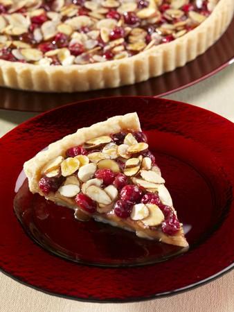 vaccinium macrocarpon: Slice of Cranberry Almond Caramel Tart; Whole Tart in the Background
